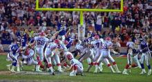 Buffalo Bills kicker Scott Norwood, center, misses the field goal on the last play of the game, clinching the victory for the New York Giants in Super Bowl XXV in Tampa Sunday, January 27, 1991.  The Giants won 20-19. (AP Photo/Phil Sandlin)
