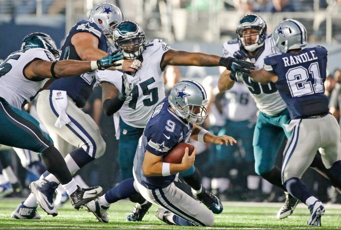 Dallas Cowboys quarterback Tony Romo (9) hits the deck for a sack under fierce pressure from Philadelphia Eagles defensive end Vinny Curry (75) in the second quarter during the Philadelphia Eagles vs. the Dallas Cowboys NFL football game on Thursday, November 27, 2014.  (Louis DeLuca/The Dallas Morning News)