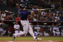 PHOENIX, AZ - APRIL 06:  Trevor Story #27 of the Colorado Rockies hits a two run home-run against the Arizona Diamondbacks during the first inning of the MLB game at Chase Field on April 6, 2016 in Phoenix, Arizona.  (Photo by Christian Petersen/Getty Images)
